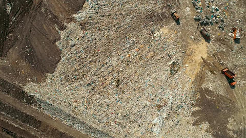 Top view of the work of refuse collection equipment disposes of waste. The Footage