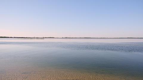view of the smooth Black Sea from the sandy shore, Ukraine Acción en vivo