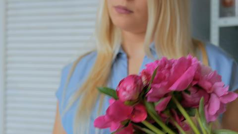 Florist woman making bunch at flower shop Footage