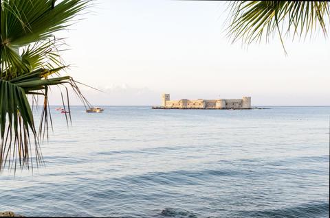 Maiden's castle, Kiz Kalesi with palm in Mediterranean Sea. Mersin Turkey Photo