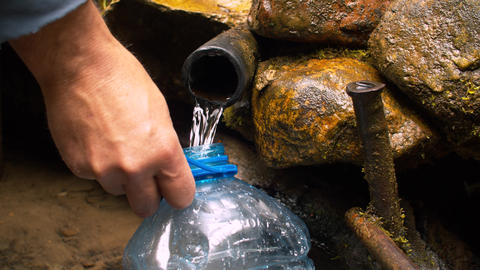 Equipped spring. Pure water running from the tube Footage