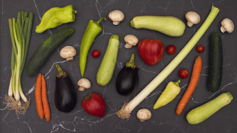 Stop motion animation of fresh and organic vegetables moving on kitchen table Animation