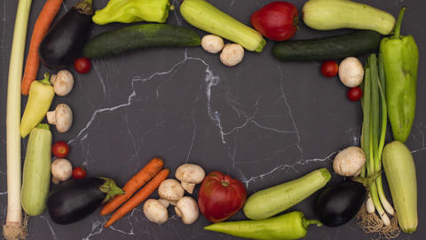 Stop motion animation of fresh vegetables making frame and leave empty space for your title Animation