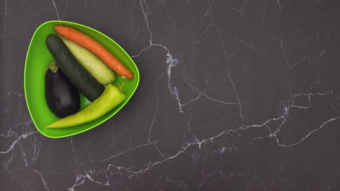 Stop motion animation of green dish filling with fresh and organic vegetables Animation
