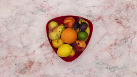 Stop motion animation of red dish filling with fruits Animation