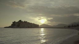 Sunset over the sea. Seascape at sunset in Sveti Stefan. Montenegro Footage