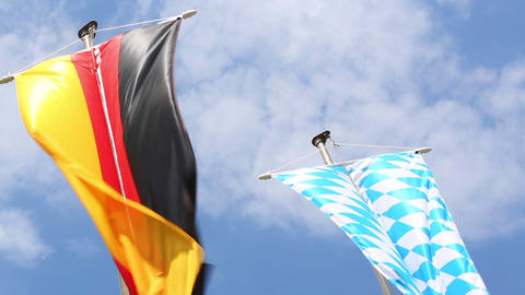 Germany and Bavaria flags in front of blue sky Footage