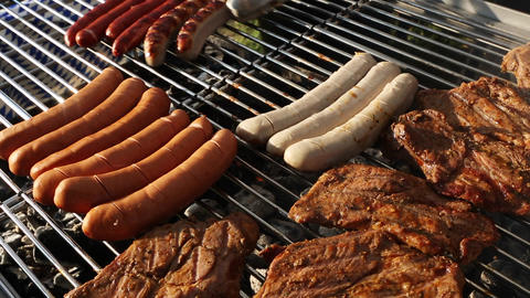 Rotate sausages on barbecue grill Footage