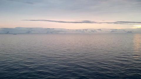 Sunrise over Brabant Island, Gerlache Strait, Antarctica Footage