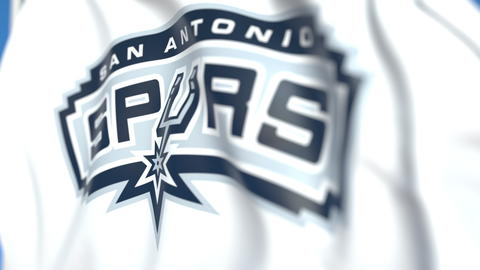 Flying flag with San Antonio Spurs team logo, close-up. Editorial 3D rendering Photo