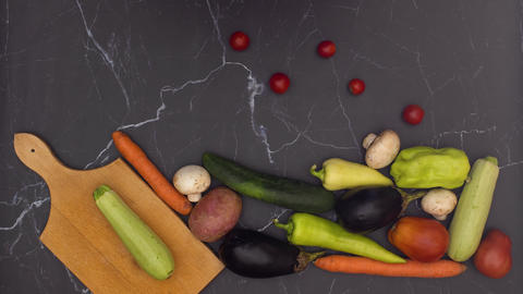 Stop motion animation of falling fresh and organic vegetables on kitchen table Animation