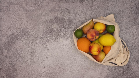 Stop motion animation of fresh fruits come into shopping bag Animation