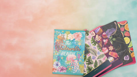 Stop motion animation of notebooks for school appearing on colorful background Animation
