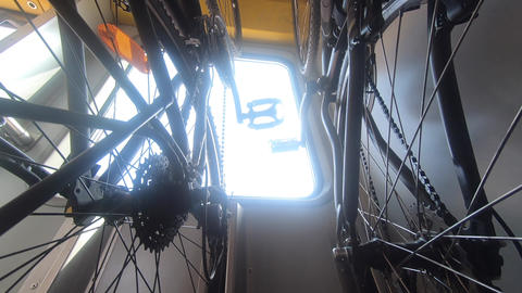 Bikes hanging on rack in train, outside activities concept Live Action