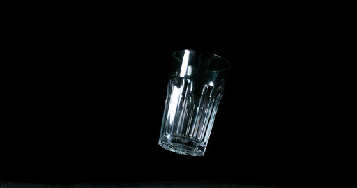 Falling Glass and Bounces on Black Background, Slow Motion 4K Live Action