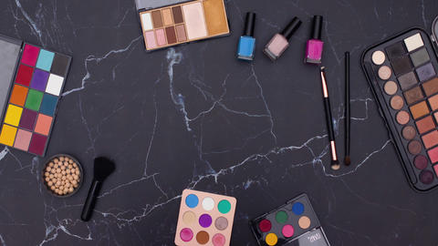 Stop motion animation of make up and cosmetics products for woman moving on the table Animation