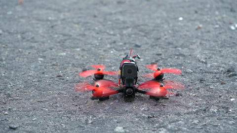 Male pilot takeing off FPV freestyle drone in the air. Slow motion Footage