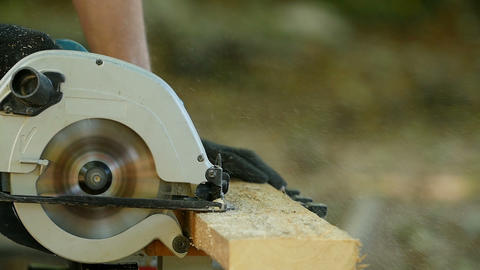 worker with a circular saw Live Action