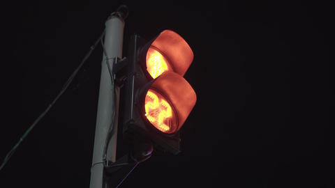 Abstract traffic lights at night. Red color of the traffic light with numbers Live Action