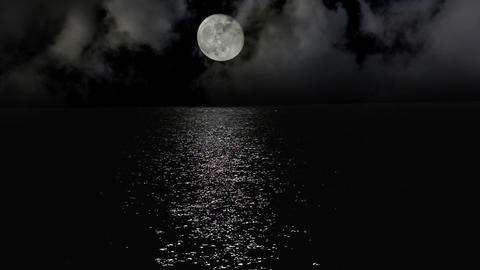 Moonlight path with low fool moon above the sea Footage