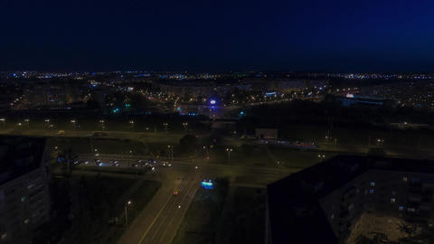 Cars moving on highway at night on city architecture landscape aerial view. Time lapse car traffic Live Action