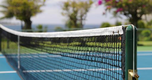 Tennis - tennis court net closeup outdoors on hardcourt tennis court Live Action