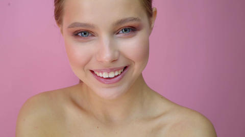 Beautiful girl at studio background, beauty concept, at pink background Footage