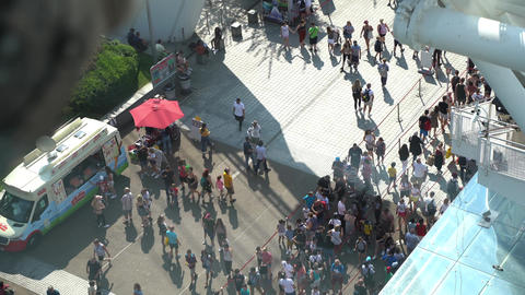 London Eye capsule view of tourists walking and queuing up to enter the London Eye on South Bank Live Action