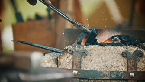 Blacksmith working with a horseshoe in his workshop - heating up the detail Live Action