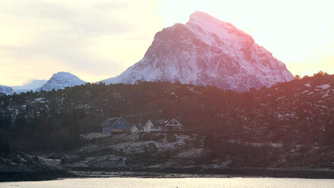 Rocky Mountain And Hilly Sea Shore With Homes In Norway Winter Sunny Weather Live Action