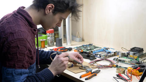 Student Working with Electronic Components Using Soldering Iron Live Action