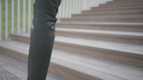 Legs of a stylish well-dressed businessman in expensive suit and shoes walking Footage