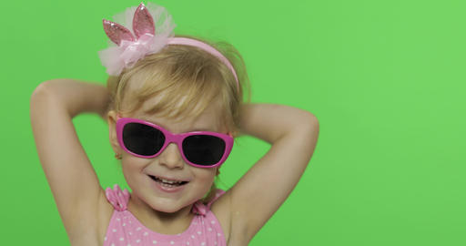 Positive girl talking to a camera in pink swimsuit and sunglasses. Chroma Key Footage