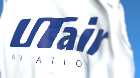 Waving flag with Utair Aviation logo, close-up. Editorial loopable 3D animation Live Action