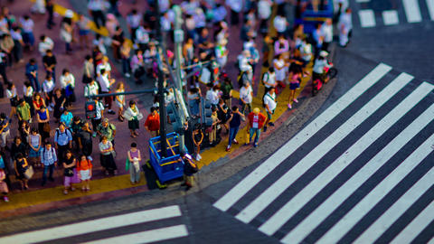 A timelapse of Shibuya crossing in Tokyo high angle tiltshift zoom Footage