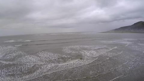 Aerial view of ocean waves in Wales Live Action