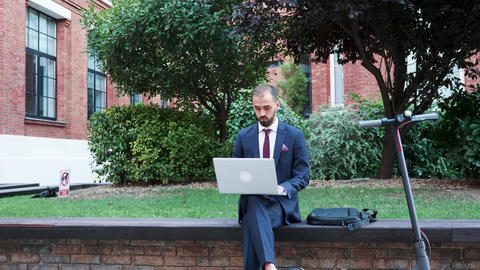 Manager in business suit working outside on the laptop Footage