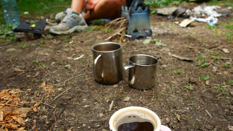 Cups with hot drinks at the campsite. Active lifestyle Footage