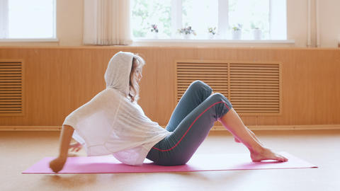 Young slim woman lying on the back in lotus position Footage