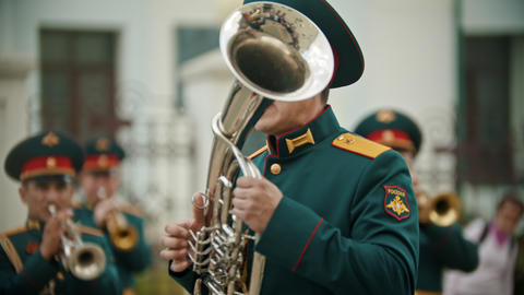 A wind instrument military parade - a man playing musical instrument outdoors Live Action