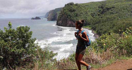 Active lifestyle woman in Hawaii beach USA vacation on Pololu Valley hike Live Action
