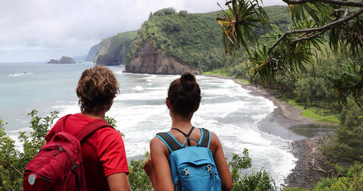 Hiking active lifestyle couple in Hawaii beach USA vacation on Pololu Valley Live Action