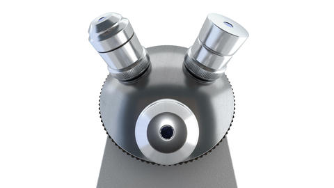 Close-up wide shof of scientific laboratory microscope changing its metal lenses Animation