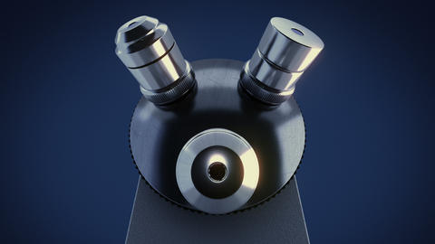 Scientific laboratory microscope in dark laboratory changing its metal lenses Animation