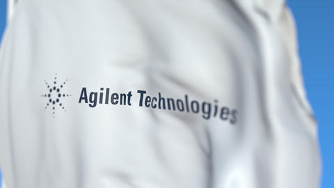 Waving flag with Agilent Technologies logo, close-up. Editorial loopable 3D Live Action