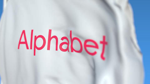 Waving flag with Alphabet Inc logo, close-up. Editorial loopable 3D animation Live Action