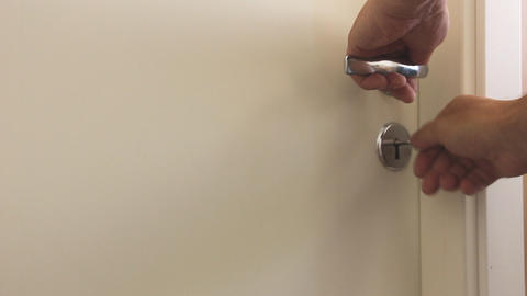 Man closes the door with a key Footage