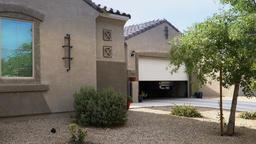 Garage Door Opens Automatically in Typical Arizona Neighborhood Footage