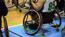 Basketball players in a wheelchair during a dead time a basketball game, extract Footage