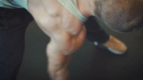 Bodybuilder do his warming workout Live Action